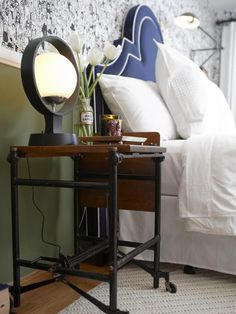 22 Cleverly Ways to Repurpose Furniture: Old metal typewriter tables can often be found at flea markets and antique shops.  These sturdy structures are a perfect height for a bedside table.  From DIYnetwork.com