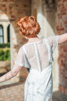Beautiful tucked hairstyle + pearl buttons, lace and fluttery sleeves. Xander and Thea Photography via Bridal Musings Wedding Blog