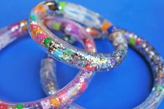 Totally Tubular Glitter Bracelets - a cousin used to have one of these when I was a kid in the 80's and I used to be mesmerized by it! Tots making one for my daughter... And one for myself!