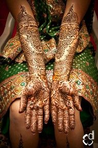 Henna Design with Crystal Gems Two arms filled with mehndi and decorated