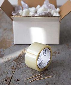 Hello Float Season - DIY tape holder: use a toothpick to keep packing tape from readhering to the roll.