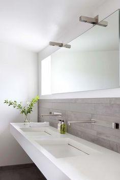 White dual sinks + vertical grey tiles - bathroom