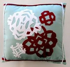 You can make the Fusible Applique Snowflake Pillowcase from old t-shirts. No new fabrics required!