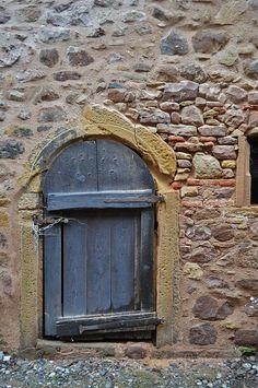 Little blue door in stone wall