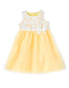 She's as sweet as a field of spring flowers in our sunny dress. Embroidered blooms accent a shiny organza skirt that floats over poofy, twirly tulle. Grosgrain ribbon and bow at the waist adds an extra girly detail.