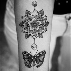 geometric butterfly forearm tattoo