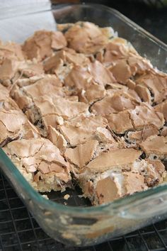 Mud Hen Bars- cookie base, topped with chocolate chips and marshmallows, with a brown sugar meringue spread all over the top.