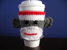 Sock Monkey Coffee Cozy... How cool is that!?!  I love it and might just have to seek out a pattern, so that I can make these, too!!!