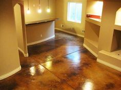 Basement remodel with matching stained concrete floors and countertop