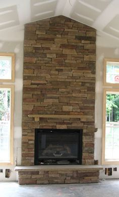 high ceilings with stone fireplace... Pretty pretty