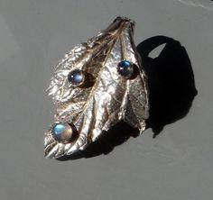 Fine silver leaf pendant with dew drops of laborite.