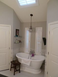 The color is actually Sherwin-Williams Repose Gray. Nice tub! http://www.bathroom-paint.net/bathroom-paint-color.php