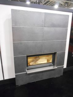 brand new TCW90 small linear WOOD burning fireplace from Town & Country (Pacific Gas) with porcelain trim. Seen at #HPBEXPO burn fireplac