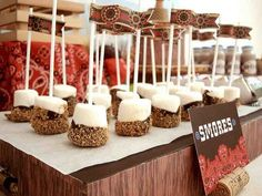 Marshmallows dipped in chocolate, rolled in graham cracker crumbles. INSTANT S'MORES!!! Perfect for wedding treats