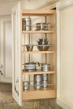 Slide-out access and adjustable shelves make this a must-have kitchen organizer. #kitchens