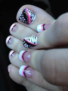 Pink black and white flower zebra toe nail design. Coordinating finger nails and toe nails.