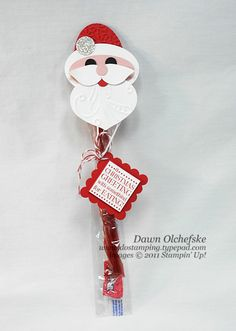 Santa punch art topper for 1x8 cello bag.  Bag works great for mini Tootsie Rolls, too.