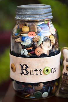 Love the embroidered button band for the jar of buttons
