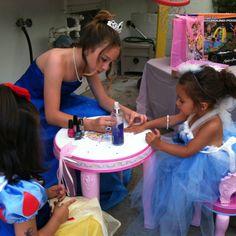 Cinderella painting nails at princess tea party