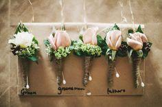 Flower pins for the groom and groomsmen #wedding #flowers #pink #bride    Photos by www.lakshalperera.com