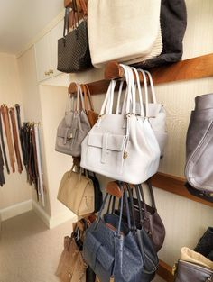 Handbag storage handles in the closet