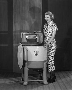 dtxmcclain:    Woman demonstrating a washing machine, 1935