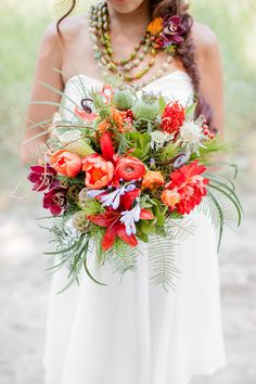 tropical bouquet, photo by Brooke Michaelson http://ruffledblog.com/out-of-africa-inspiration-shoot #weddingbouquet #flowers
