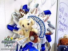 Make your homecoming mum or garter stand out this year.  Accessorize your mums with Sports Roses - Featuring petals made from the covers of baseball, footballs, and softballs.  Available here:  http://sportro.se/mums-garters