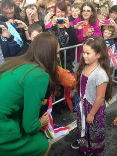 Kate stops and talks to a young girl while in Hamilton, NZ