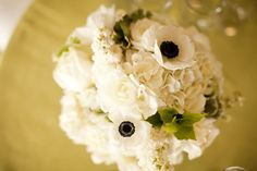 An all-white bouquet peppered with black anemone centers. Allyson Magda Photography. Camilla Svensson Burns Couture Floral.