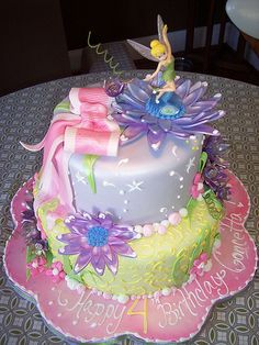 Tinker Bell Cake   My great granddaughter's next birthday cake for sure.  She would love this.  Jenny we'll work on this one.