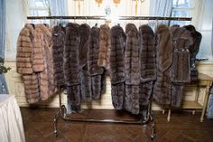 Rack of sable fur coats.