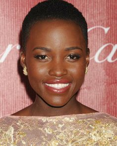 """On cheeks and lips, I wanted to have a soft, lady like rose petals effect by staining it with deep pink stain (Votre Vu Vu On Rouge in Ma Cherry)."" -- Nick Barose, makeup artist to Lupita Nyong'o at the Palm Springs Film Festival."
