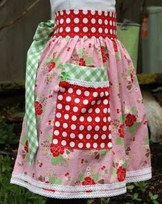 """Aprons by Lori Holt... made from her fabric line """"Sew Cherry""""."""