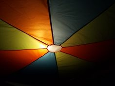 i took a cheap parachute from the craft store and hung it from the ceiling to resemble the inside of a circus tent