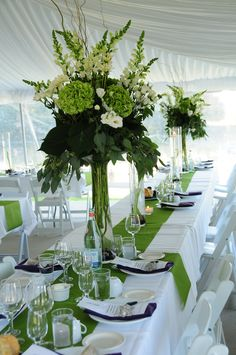 REAL DOOR COUNTY WEDDING. Tall, green wedding reception centerpieces. Photography by Art of Exposure.