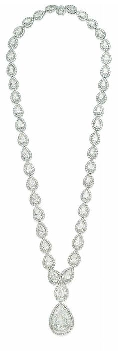 A DIAMOND NECKLACE.  Designed as a series of graduated pear-shaped diamonds, each in a pavé-set diamond surround, suspending a similar pendant set with a larger pear-shaped diamond, mounted in gold, 40.5 cm
