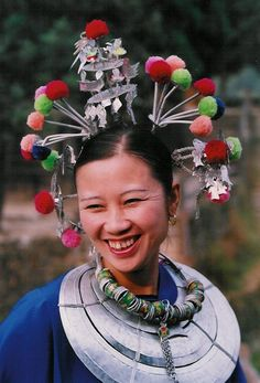 This woman was photographed in China.  Unfortunately the photographer (jomo01 on nationalgeographic.nl) did not provide any other details.