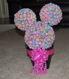 minnie mouse birthday party ideas-with red & white suckers and little red bow for center piece