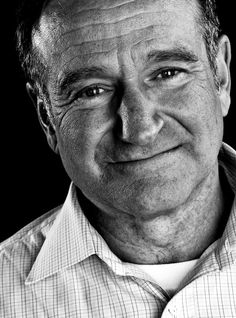 Robin Williams - A woman appreciates a man who can make her laugh