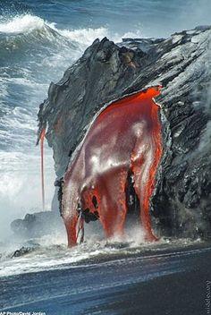 Lava running into the ocean.
