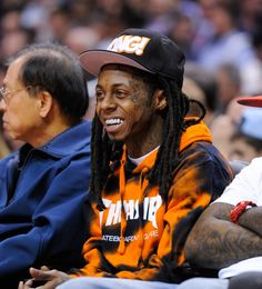Weezy F Baby, aka Lil Wayne, enjoys his courtside seat at the Houston Rockets versus Los Angeles Clippers game on Feb. 26, 2014 in Los Angeles at Staples Center DTLA. Check out Celebs Spotted at Staples Center! http://celebhotspots.com/hotspot/?hotspotid=6465&next=1