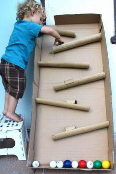 #DIY A ball maze created from a cardboard box and paper towel rolls. Fun ! Ball, Cardboard Boxes, Toy, Paper Towel Rolls, Game, Toddler, Cardboard Tubes, Kid, Cardboard Crafts