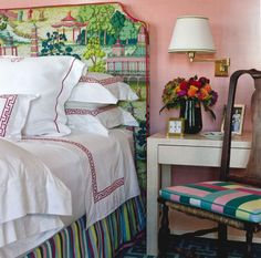 Pink bedroom with a colorful headboard by designer Gary McBournie