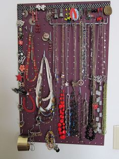 "Reader Annelise writes in about her jewelry storage solutions: ""I wanted to share one of my favorite projects--jewelry storage by pegboard. Make them cut it to whatever size you want at the hardware store, attach picture-hanging hardware, paint it and hang it up. I've added ribbon for pins and more dangly earrings, though you can just use the holes themselves, and you can get a huge assortment of hooks that seem like they're tailor-made for ridiculous bangles."""