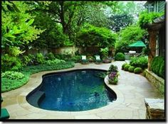 same small pool  Looks like our pool, look what can be done with pavers and a resurface.