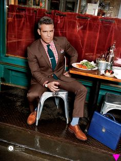 Andy Cohen—Plaid shirt by Kiton, tie by Hook+Albert, suit by Ralph Lauren Black Label, shoes by Brunello Cucinelli, and briefcase by Salvatore Ferragamo