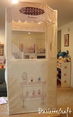 Play Bakery made from PVC and Canvas; how fun would it be to make one frame and house different covers; Bakery, grocery, movie theater, post office, etc., so the kids can switch it to fit their play?!