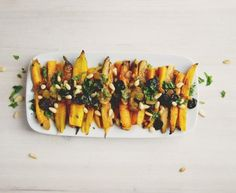 Roasted Curried Carrot Salad with Raisins and Pine Nuts   KitchenDaily.com