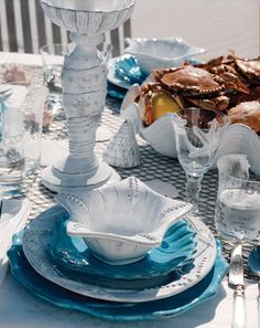 A shell collector's treasure for the table, Incanto Mare features the shapes of the sea on white and aqua pieces for an ocean inspired setting!